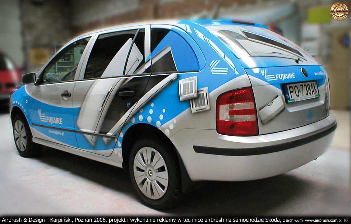 Projekt i wykonanie reklamy w technice airbrush na samochodzie Skoda dla firmy Lars.